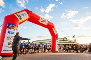 RD Adrian Bailey sounds the horn and unleashes the eager runners, Day 1, Marathon 1.