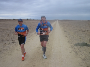 Duncan running with the man who strode the length of the planet, Pat Farmer
